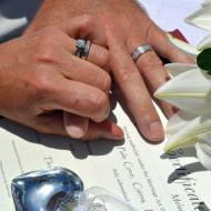 Signing at Beach Wedding with Cairns Civil Marriage Celebrant, Melanie Serafin